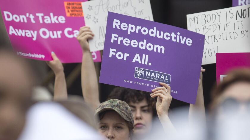 Abortion rights protestors rally outside of the Georgia State Capitol following the signing of HB 481,