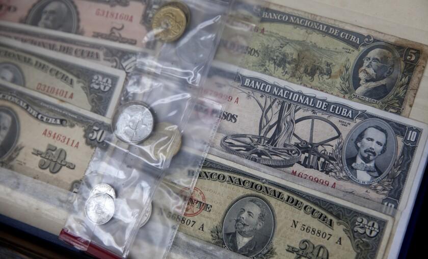 Pre-revolutionary Cuban coins and banknotes for sale in the Plaza de Armas, Havana Vieja, Cuba April 24, 2015.