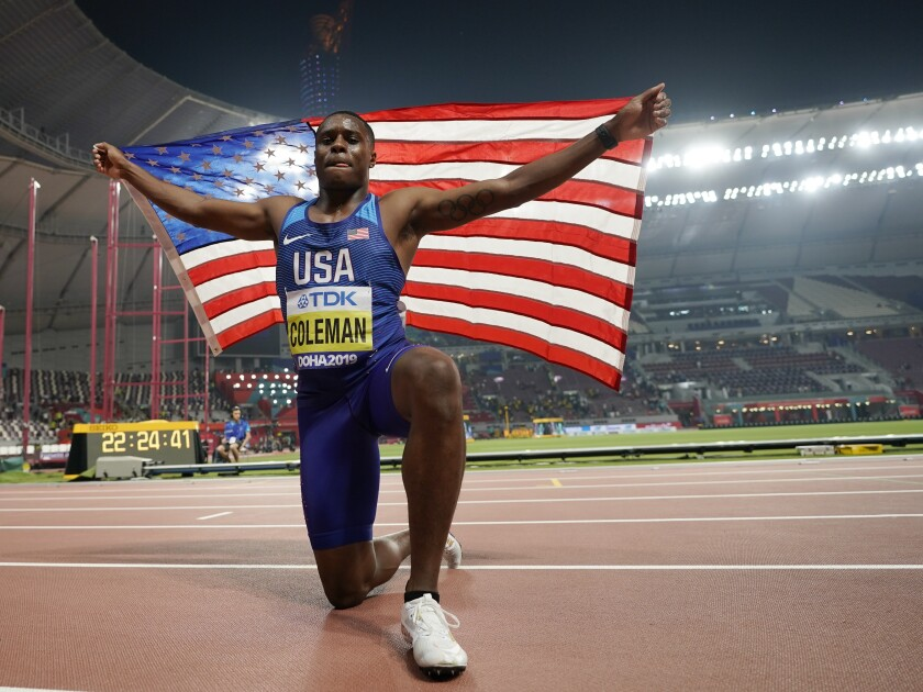 U.S. sprinter Christian Coleman celebrates after winning the men's 100 meters at the World Athletics Championships in 2019.