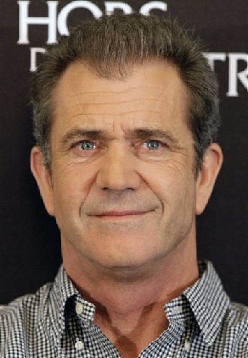 """FILE - In this Feb. 4, 2010 file photo, actor Mel Gibson looks on during a photocall to promote the movie """"Edge of Darkness"""", in  Paris. Gibson is expected to be charged Friday March 11, 2011 with misdemeanor battery and appear in a Los Angeles courtroom to plead guilty and be sentenced. (AP Photo/"""
