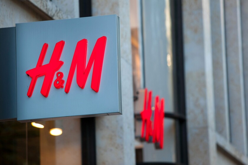 H&M, the world's second-largest retailer, said Monday it plans to pay 850,000 textile workers a living wage by 2018. Above, an H&M store in Germany.