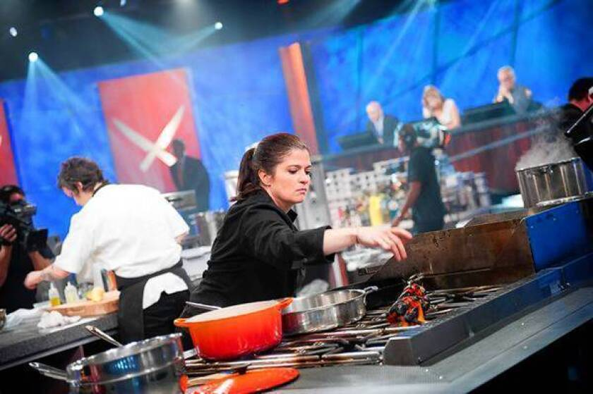 """Alex Guarnaschelli takes part in Food Network's """"The Next Iron Chef"""" show. Tribune Co. is expected to maintain its 30% stake in the profitable network."""