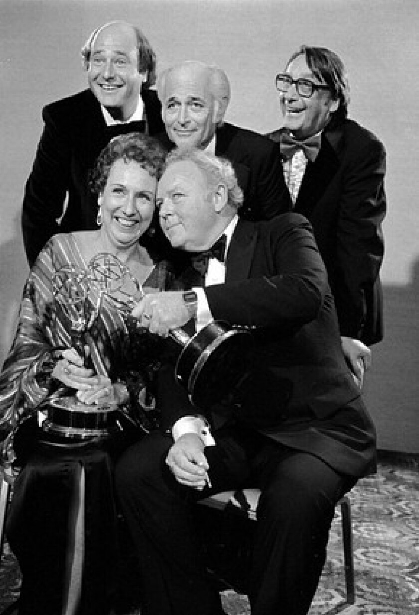 """Morton Lachman, top right, was executive producer of """"All in the Family."""" Holding Emmys they won in 1978 for their performances on the TV sitcom are co-stars Jean Stapleton and Carroll O'Connor. At rear is Rob Reiner, left, who won an Emmy for supporting actor, and producer Norman Lear."""