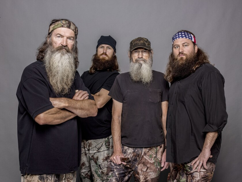 """This 2012 photo released by A&E shows, from left, Phil Robertson, Jase Robertson, Si Robertson and Willie Robertson from the A&E series """"Duck Dynasty."""""""