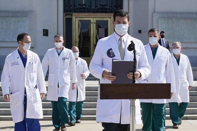 Dr. Sean Conley, physician to President Donald Trump, and other doctors brief reporters on Sunday.