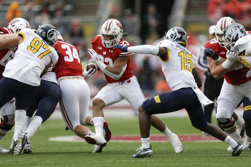 Wisconsin running back Jonathan Taylor (23) runs against Kent State cornerback Keith Sherald Jr. (15) during the first half of an NCAA college football game Saturday, Oct. 5, 2019, in Madison, Wis. (AP Photo/Andy Manis)