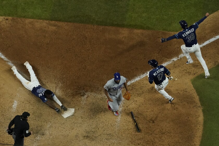 Tampa Bay Rays' Randy Arozarena touches after scoring the winning run against the Los Angeles Dodgers.