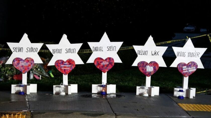 Stars of David with the names of five of the 11 people killed at the Tree of Life Synagogue on Oct 28 are part of a memorial outside the Pittsburgh temple.