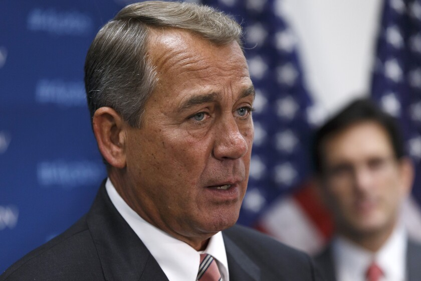 House Speaker John A. Boehner (R-Ohio) meets with reporters after a Republican caucus on Capitol Hill.