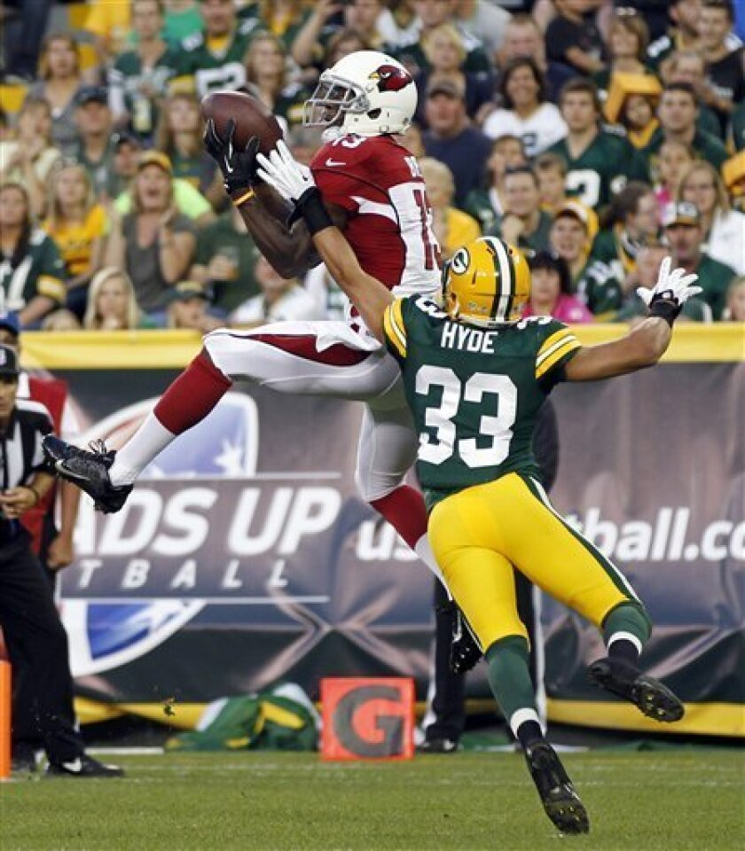 Arizona Cardinals' Jaron Brown catches a touchdown pass in front of Green Bay Packers' Micah Hyde (33) during the first half of a preseason NFL football game Friday, Aug. 9, 2013, in Green Bay, Wis. (AP Photo/Mike Roemer)