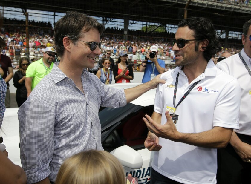 Pace car driver Jeff Gordon, left, talks with former Indy 500 champion Dario Franchitti before driving the pace car for the 99th running of the Indianapolis 500 auto race at Indianapolis Motor Speedway in Indianapolis, Sunday, May 24, 2015. (AP Photo/Darron Cummings)
