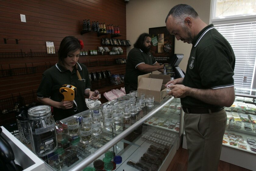Zach Lazarus labeled jars in March at the city of San Diego's first legal dispensary in Otay Mesa.