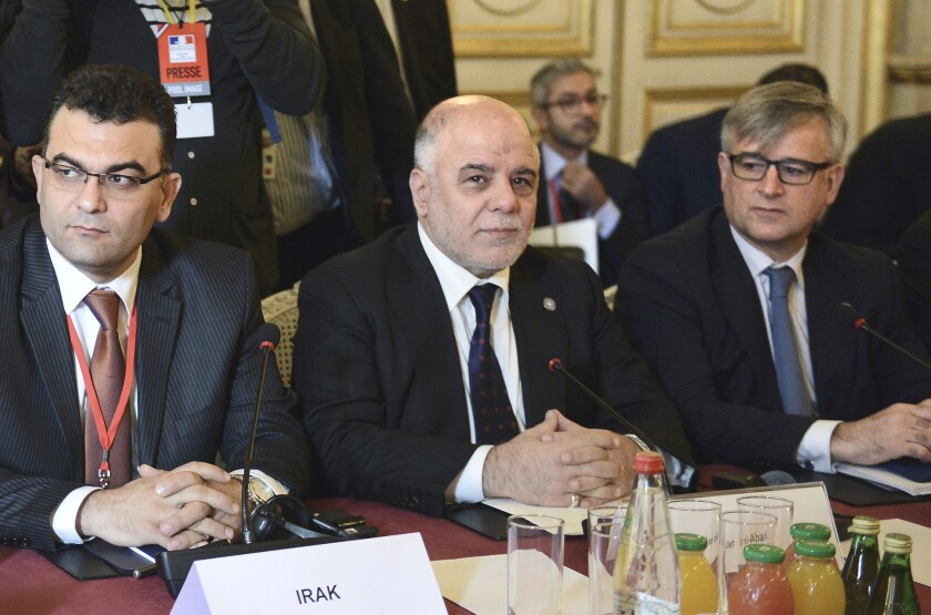 Iraqi Prime Minister Haider Abadi, center, and members of the anti-Islamic State coalition meet in Paris to discuss strategy on June 2.