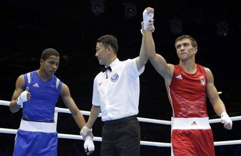 Ukraine's Vasyl Lomachenko, right, wins his lightweight 60-kg quarterfinal boxing match over Puerto Rico's Felix Verdejo Sanchez at the 2012 Summer Olympics, Monday, Aug. 6, 2012, in London. (AP Photo/Patrick Semansky)