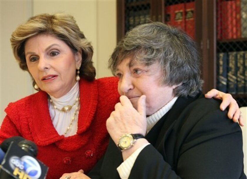 Robin Tyler, right, who with her partner Diane Olson, not shown, became the first same-sex couple to wed in Los Angeles County in 2008, sits with her attorney Gloria Allred as they learn about the 9th U.S. Circuit Court of Appeals' decision on the validity of gay marriage, in Los Angeles Tuesday, Feb. 7, 2012. The federal appeals court declared California's same-sex marriage ban, passed as Proposition 8 in 2008, to be unconstitutional, putting the bitterly contested, voter-approved law on track for likely consideration by the U.S. Supreme Court. (AP Photo/Reed Saxon)