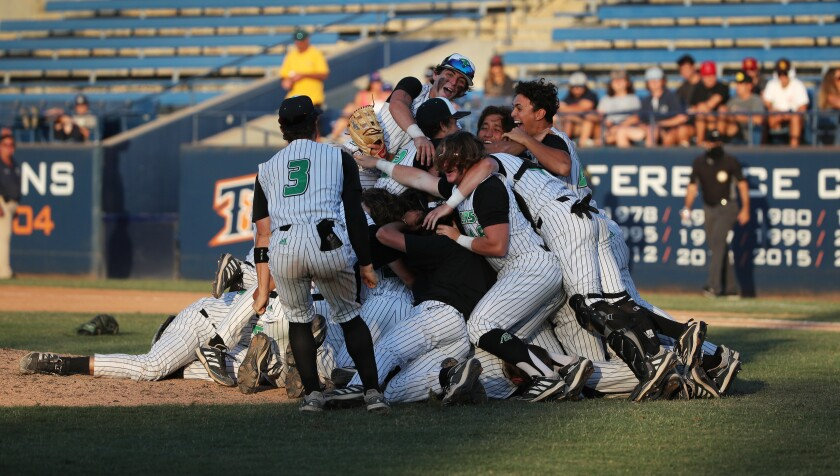 Thousand Oaks baseball players celebrate their win over Trabuco Hills in the Southern Section Division 2 championship game.