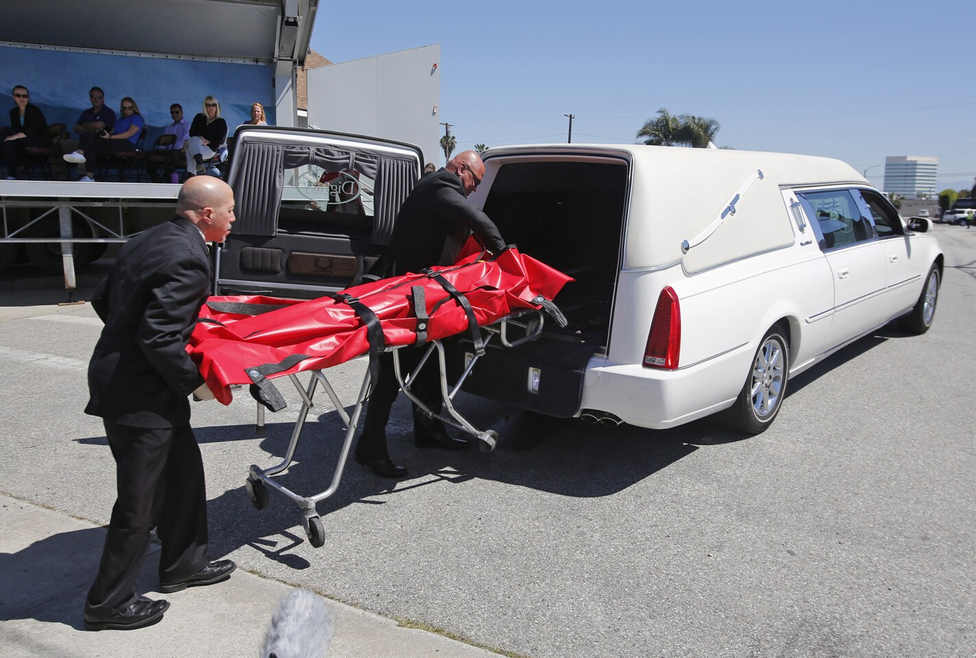 """Local coroners take away a mock fatality during a live accident reenactment for the """"Every 15 Minutes"""" program to emphasize the dangers of driving under the influence to students at Ocean View High School in Huntington Beach on Monday."""