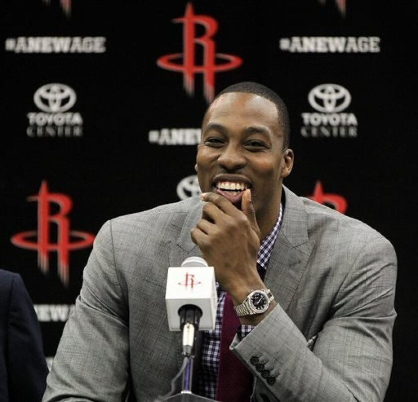 Houston Rockets' Dwight Howard smiles during a news conference and welcoming ceremony for him to the NBA basketball team, Saturday, July 13, 2013, in Houston. (AP Photo/Houston Chronicle, Karen Warren) MANDATORY CREDIT