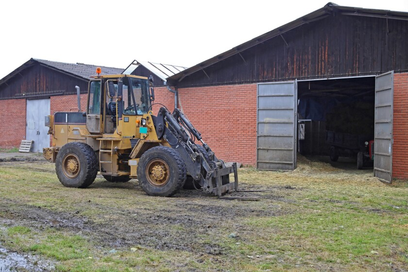 An inquest has confirmed that a British farmer was killed when his dog (not pictured) drove forklift similar to this one and fatally crushed him.
