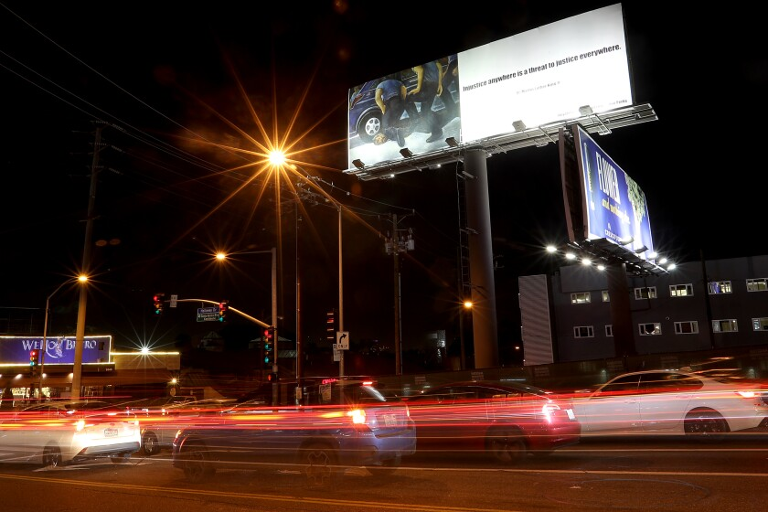 A billboard at La Cienega and Holloway in West Hollywood depicts the death of George Floyd at the hands of police.