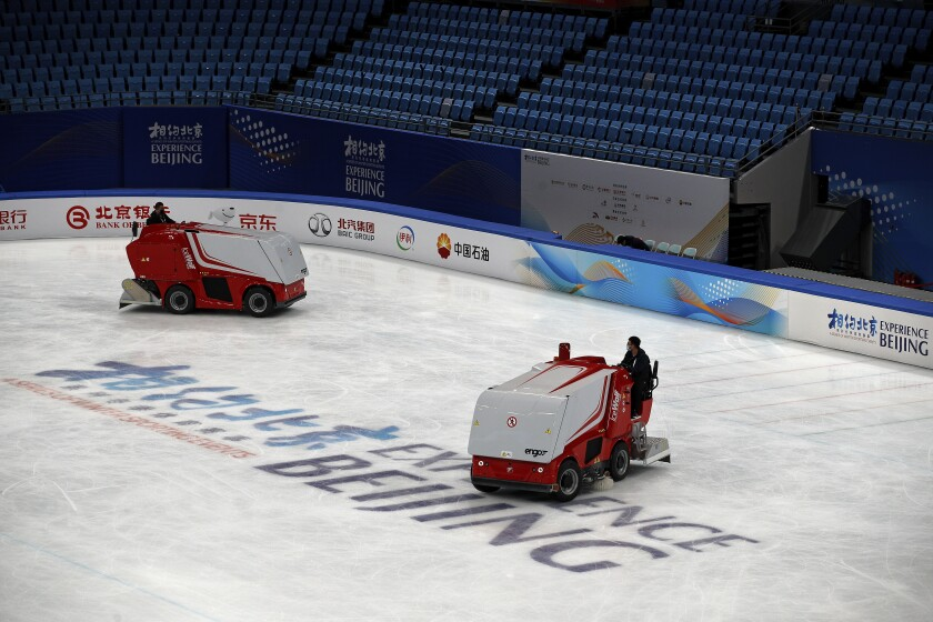 Zambonis resurface the ice skating rink at the Capital Indoor Stadium in Beijing