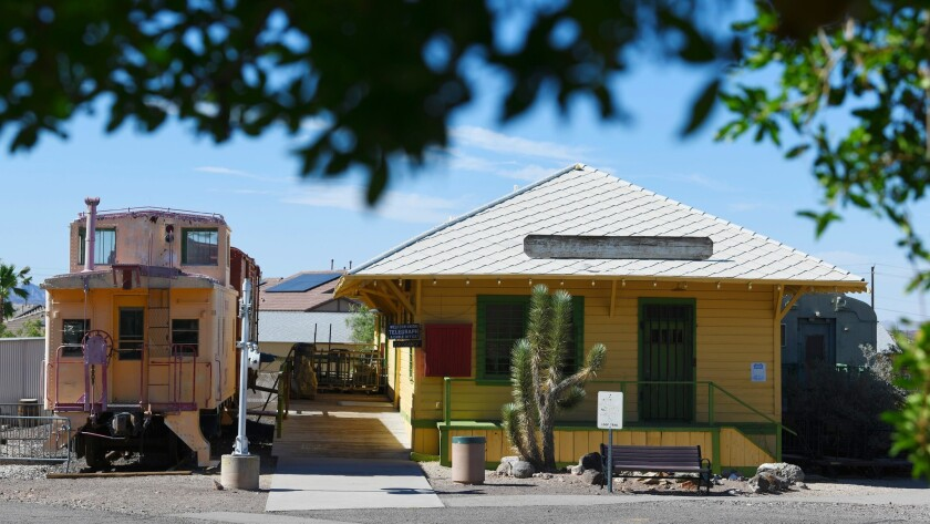 A Union Pacific caboose and the old Boulder City train depot are seen at the Clark County Museum Thu