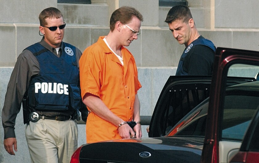 Dustin Honken is led by federal marshals to a waiting car in Sioux City, Iowa, in 2004.
