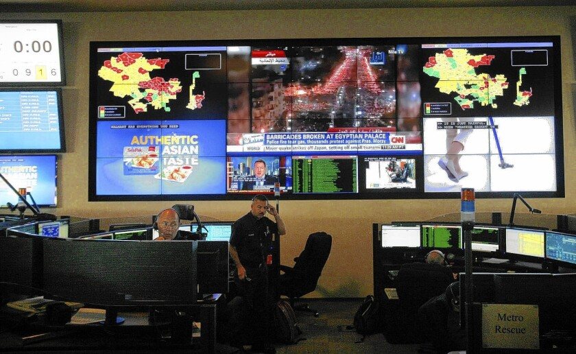 The Los Angeles Fire Department's dispatch center. A consultant's report commissioned by the city recommends significant and potentially costly changes at the troubled agency, which has faced scrutiny over increasing response times to medical emergencies and recurring problems inside the center.