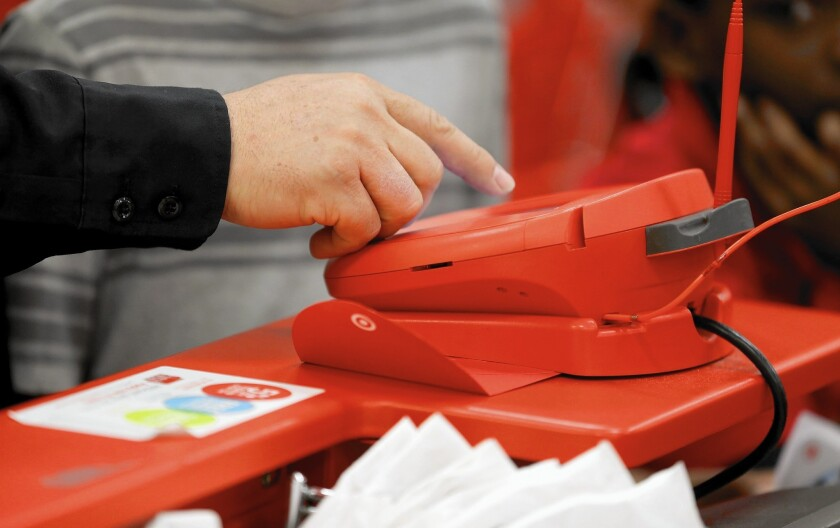 Two massive hacks last year at Target Corp. and daily deals website LivingSocial each hit roughly 7.5 million Californians. Above, a Target credit card scanner in Miami.