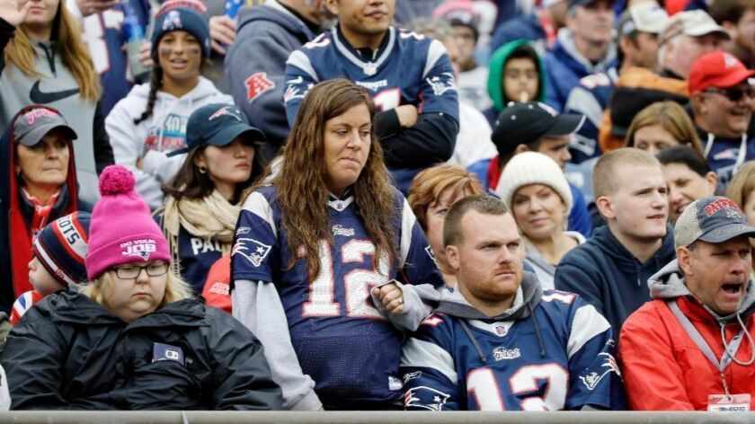 New England Patriots fans watch as the clock winds down on their team's 16-0 loss to the Buffalo Bills on Oct. 2.