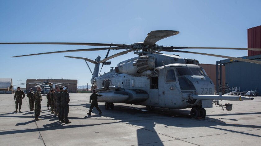 Troops discuss the capabilities of a CH-53 Super Stallion during a tour of Marine Corps Air Station Yuma, Ariz. on March 26.