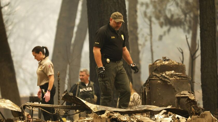 Search crews work in Paradise, Calif., after the Camp fire in November.