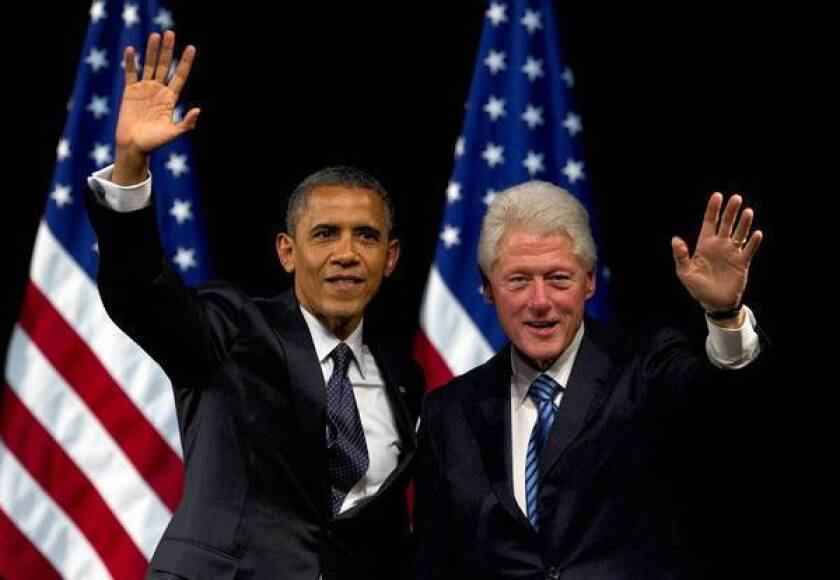 Former President Clinton helps President Obama campaign in New York in July.