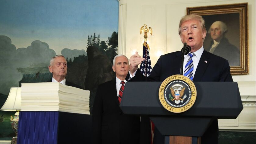 President Donald Trump with, Defense Secretary Jim Mattis, left, and Vice President Mike Pence, speaks in the White House on March 23 about the $1.3 trillion spending bil.