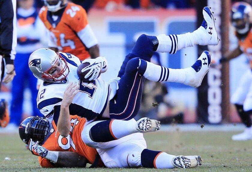 Tom Brady getting sacked by the Broncos.