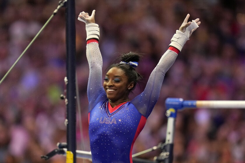 Simone Biles reacts after her uneven bars routine at the U.S. Olympic trials June 25, 2021.