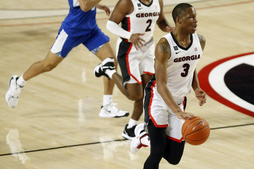 Georgia's Christian Brown (3) moves the ball along the court during the team's NCAA college basketball exhibition game against North Georgia in Athens, Ga., Wednesday, Dec. 2, 2020. (Joshua L. Jones/Athens Banner-Herald via AP)