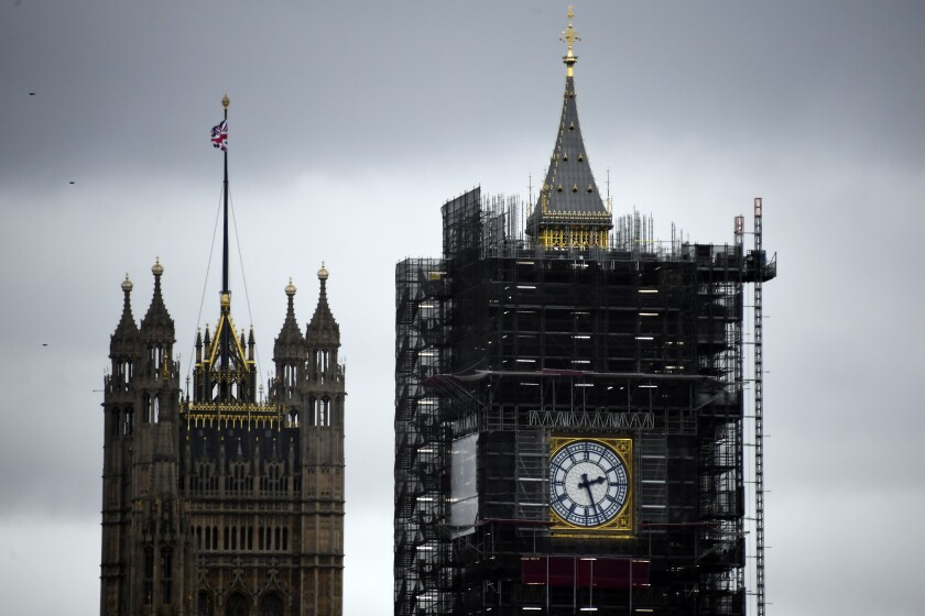 """A view of the Victoria Tower, left, and the Elizabeth Tower, which holds the bell known as """"Big Ben"""", in London, Friday, Nov. 1, 2019. British euroskeptic politician Nigel Farage is trying to ramp up the pressure on Conservative Prime Minister Boris Johnson. He warned that his Brexit Party will run against the Conservatives across the country in the Dec. 12 general election unless Johnson abandons his divorce deal with the European Union. (AP Photo/Alberto Pezzali)"""
