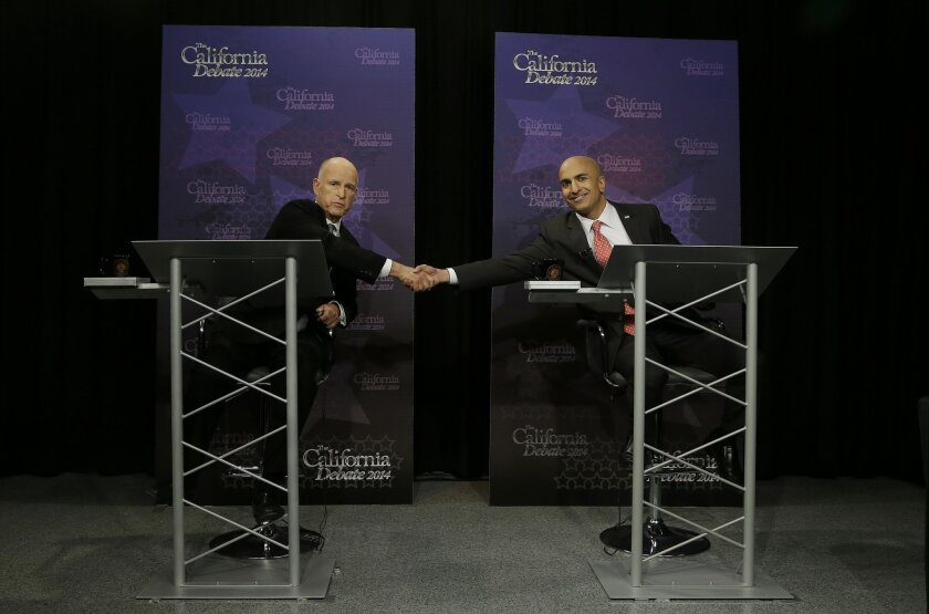 Gov. Jerry Brown, left, shakes hands with Republican challenger Neel Kashkari as they pose for photographs before a gubernatorial debate in Sacramento, Calif., Thursday, Sept. 4, 2014. Thursday's debate is likely to be the only one of the general election. (AP Photo/Rich Pedroncelli, Pool)