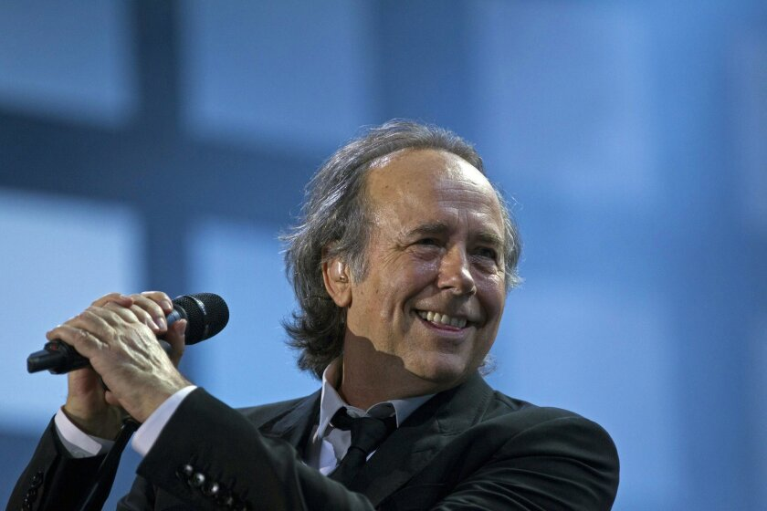 """FILE - In this March 17, 2012 file photo, Joan Manuel Serrat smiles while performing with fellow artist, Joaquin Sabina in their """"Dos Pajaros Contraatacan,"""" or """"Two Birds Strike Back,"""" tour in Buenos Aires, Argentina. The Spanish singer-songwriter has been named the 2014 Latin Recording Academy Person of the Year announced the Latin Grammy organization Tuesday, Sept. 9, 2014. (AP Photo/Natacha Pisarenko, File)"""