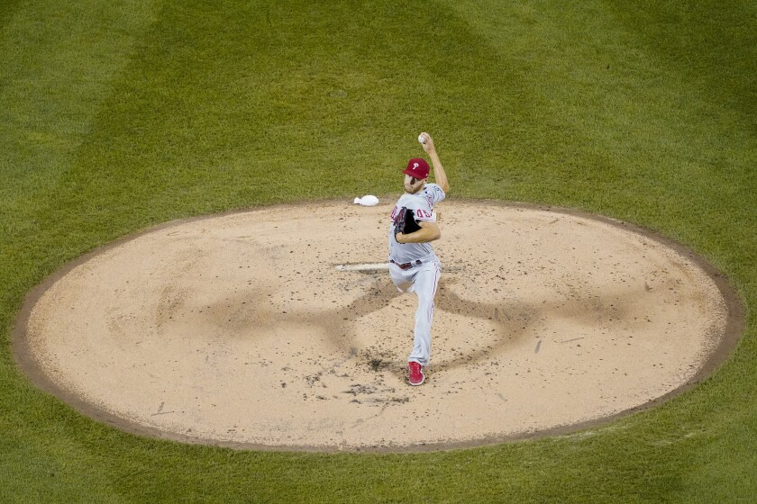 Philadelphia Phillies pitcher Zack Wheeler delivers against the New York Mets during the second inning of a baseball game, Friday, Sept. 17, 2021, in New York. (AP Photo/Mary Altaffer)