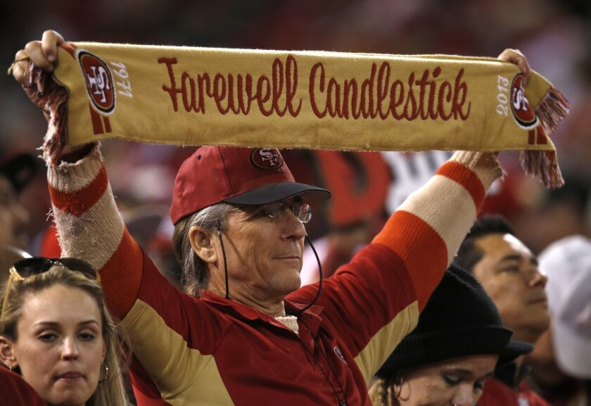A 49ers fan holds up a scarf during the team's game Monday against the Atlanta Falcons at Candlestick Park in San Francisco.