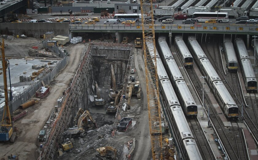 FILE - This photo taken on Thursday April 17, 2014, shows ongoing construction of a rail tunnel, left, at the Hudson Yards redevelopment site on Manhattan's west side in New York. Amtrak is constructing an 800-foot-long concrete box inside the project to preserve space for a tunnel from Newark to New York City that would allow it to double rail capacity across the Hudson River. (AP Photo/Bebeto Matthews, File)