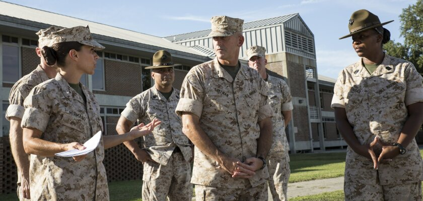 Lt. Col. Kate Germano gives a tour of the 4th Recruit Training Battalion barracks complex to Maj. Gen. James Lukeman, the commanding general of Marine Corps Training and Education Command, in October 2014, on Parris Island, S.C. Germano spoke about the future of women at the boot camp, how to improve training for recruits, and the quality of life of her drill instructors. (Photo by Cpl. David Bessey, USMC/released)