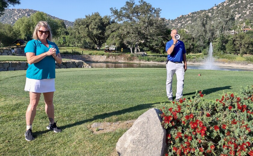 Shelly Heimer and Mt. Woodson Golf Club PGA Head Professional Perry Dotson help organize the FORUS Golf Tournament.