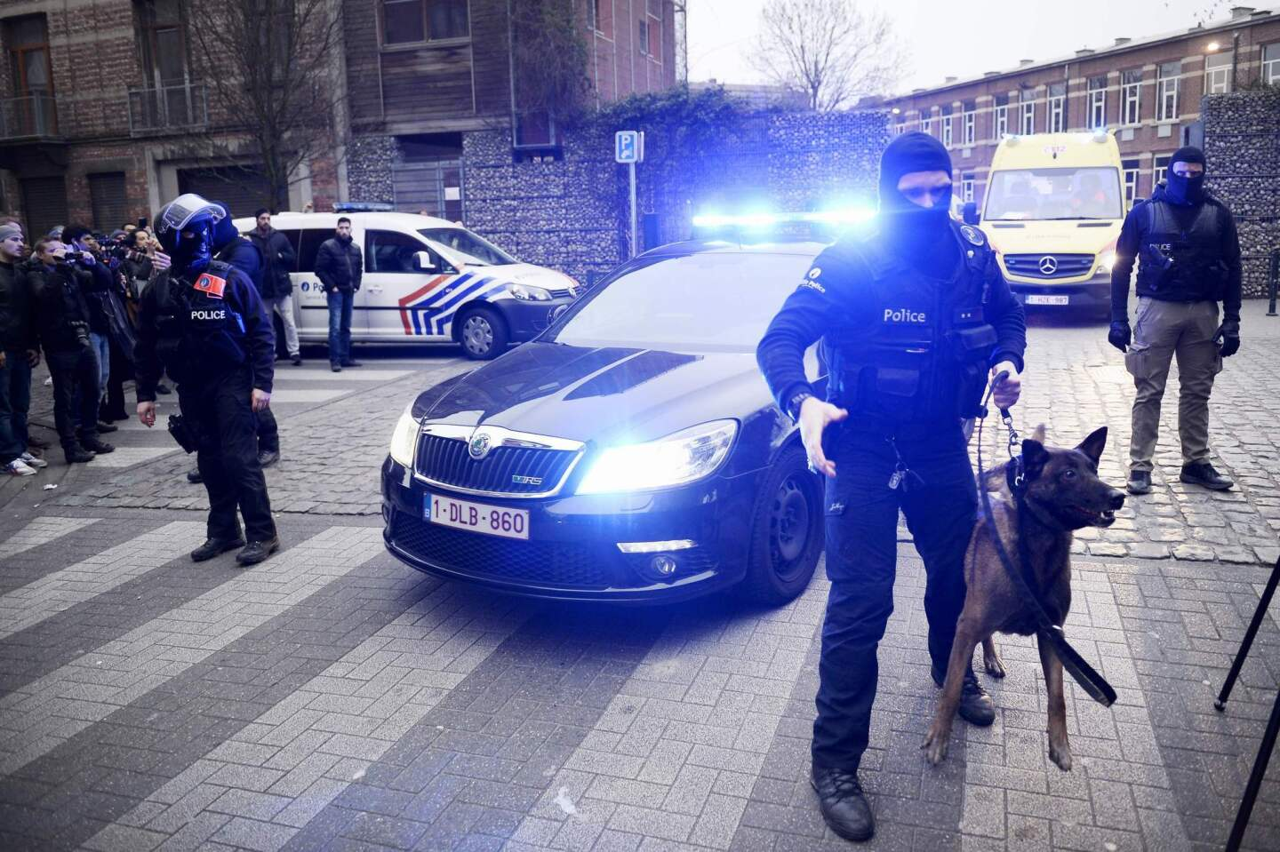Policemen block a road near the scene of a police raid in the Molenbeek-Saint-Jean district in Brussels as part of the investigation into the November attacks in Paris. The main suspect in the jihadist attacks on Paris, Salah Abdeslam, was arrested in the raid.