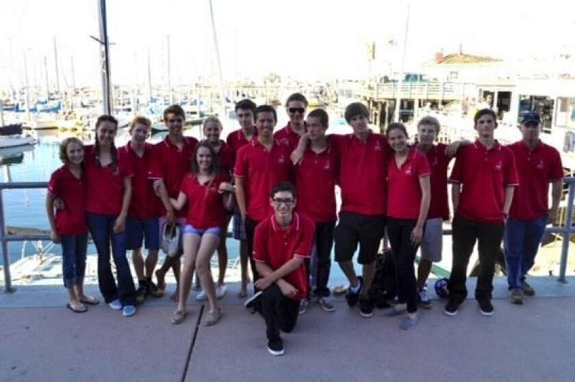 Team members of the Cathedral Catholic High School Sailing team pose with their coach Brian Stanford in Monterey, Calif., Oct. 14 following their 1st place finish in the Sea Otter Regatta.