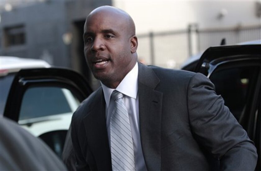 Former baseball player Barry Bonds arrives for his trial at federal court in San Francisco, Tuesday, April 5, 2011. (AP Photo/Jeff Chiu)