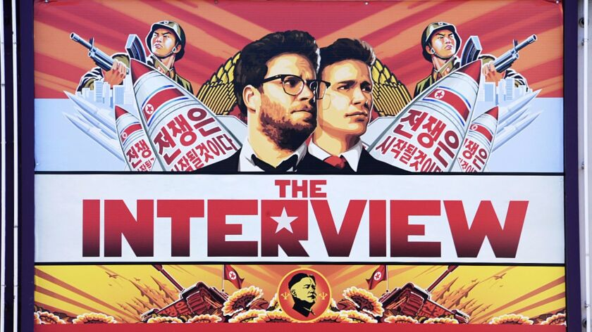 "A poster for ""The Interview"" is displayed on the marquee of the Los Feliz 3 theater on Dec. 25, 201"