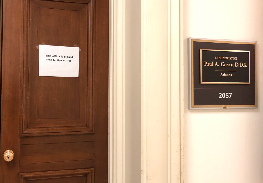 "The Capitol Hill office door of Rep. Paul Gosar, R-Ariz., has a sign that reads, ""This office is closed until futher notice,"" shown Monday, March 9, 2020 on Capitol Hill in Washington. On Sunday, Sen. Ted Cruz, R-Texas, and Gosar said they're isolating themselves after determining they had contact with a person at a Maryland political conference who got COVID-19. (AP Photo/Padmananda Rama)"